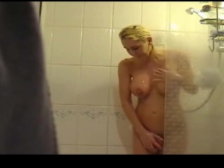 Hot busty gal takes shower  Preview