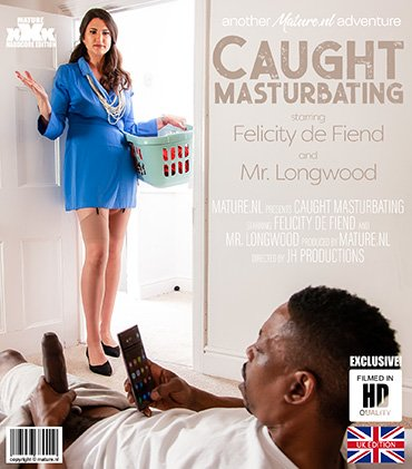 Tall MILF catches black guy jerking off his big black cock  Preview