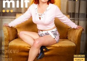 MATURE NL Shaved redhead MILF Sunny Q is getting frisky